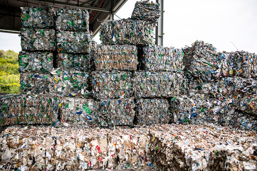 Waste Management「Bales of Compressed Recyclable Materials Stacked Outdoors」:スマホ壁紙(12)