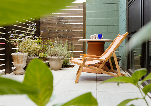Deck Chair「Landscaping and patio of modern condo building」:スマホ壁紙(3)
