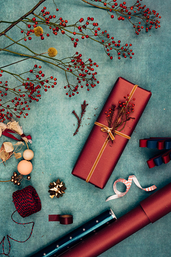 Christmas Paper「Beautifully Wrapped Christmas Present Surrounded by Various Christmas Decorative Items, a Flat Lay」:スマホ壁紙(18)