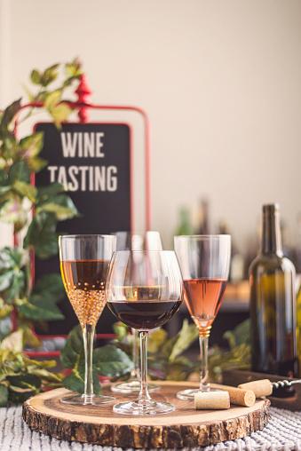 Tasting「Wine tasting theme with various bottles of wine and glasses」:スマホ壁紙(3)