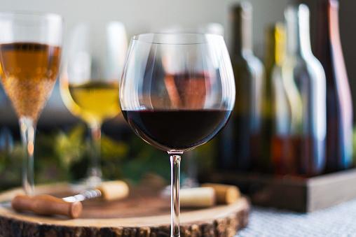Tasting「Wine tasting theme with various bottles of wine and glasses」:スマホ壁紙(5)