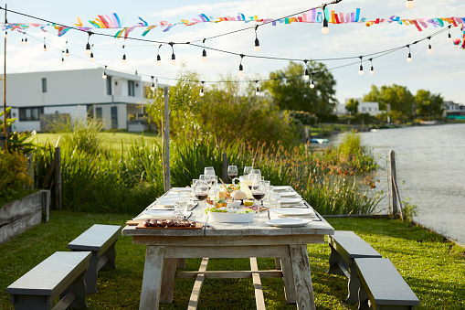 Buenos Aires「Place setting on table during Asado party in yard」:スマホ壁紙(11)