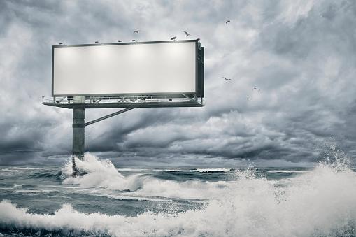 Extreme Weather「Blank billboard standing in the ocean」:スマホ壁紙(10)