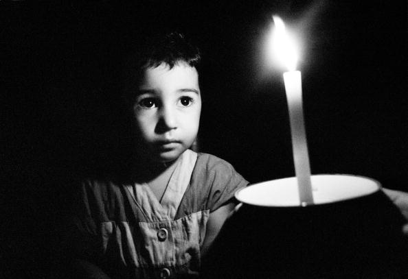 Brown Hair「Lebanon, Beirut, child sheltering from bombing holding up candle」:写真・画像(2)[壁紙.com]