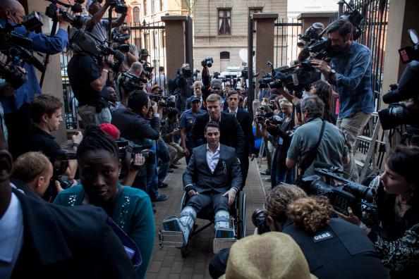 Carl Court「The Judge Reaches Her Verdict In The Trial Of Oscar Pistorius」:写真・画像(9)[壁紙.com]