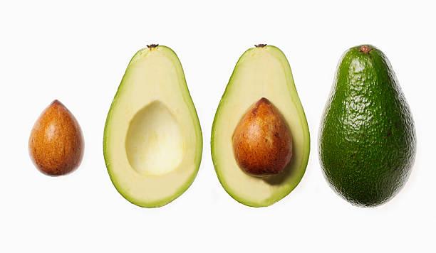 Whole avocado, slices and pits:スマホ壁紙(壁紙.com)