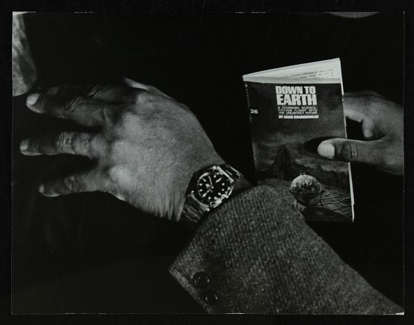 Wristwatch「The hands and book of American double bassist Eddie Jones, Welwyn Garden City, Hertfordshire, 1967. .」:写真・画像(0)[壁紙.com]