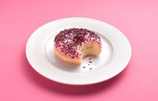 Unhealthy Eating「Can't resist temptation bite out of doughnut」:スマホ壁紙(9)