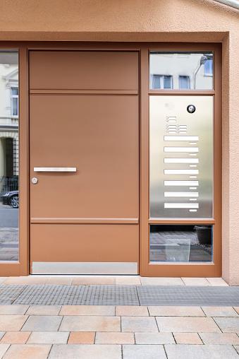 Front Door「Front door, modern building with a brown front door.」:スマホ壁紙(7)