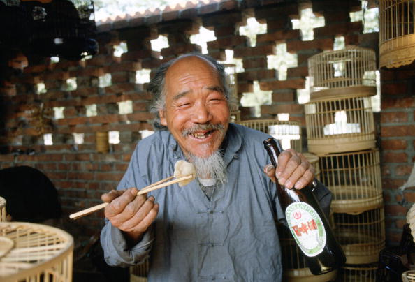 Adult「Man Eating and  Drinking, Beijng, China」:写真・画像(3)[壁紙.com]