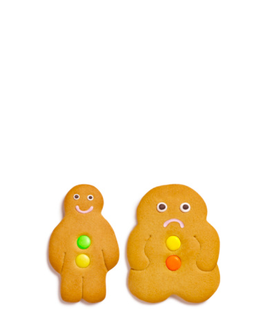Fat - Nutrient「Two gingerbread cookies on white background, close-up」:スマホ壁紙(10)