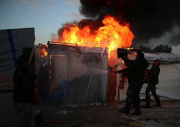 Calais「Migrants Leave The Jungle Refugee Camp In Calais」:写真・画像(1)[壁紙.com]