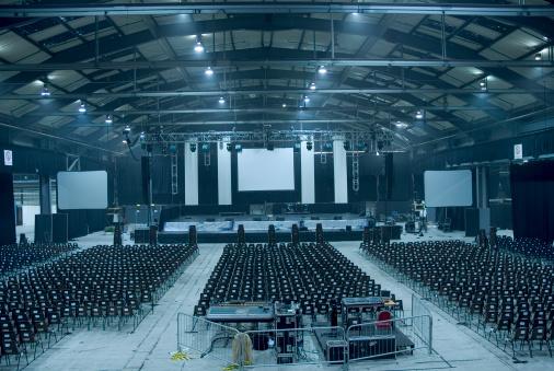 Convention Center「Dark blue-toned large empty auditorium hall」:スマホ壁紙(5)
