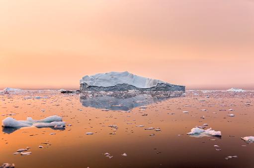 Climate Change「Iceberg on beautiful sea in the sunset」:スマホ壁紙(1)