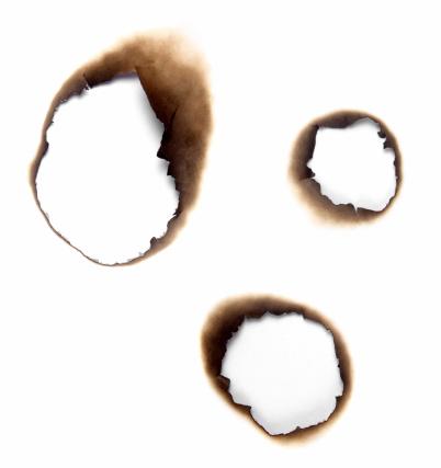 Burnt「Burnt holes in a piece of paper」:スマホ壁紙(2)