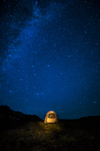Camping「Milky Way over glowing tent at night sky in San Juan Mountains, Colorado」:スマホ壁紙(10)