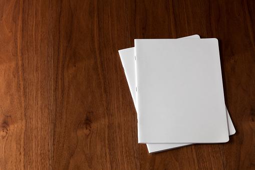 File「Two blank magazines on a wooden floor」:スマホ壁紙(17)