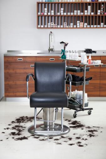 Brown Hair「An empty barber chair with cut hair around it」:スマホ壁紙(9)