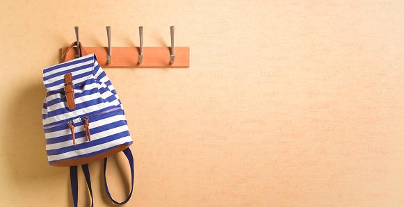 Individuality「Rucksack hanging ready on coat hook in hallway」:スマホ壁紙(9)