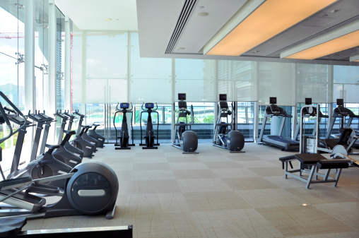 Health Club「An empty gym room with rows of running machines」:スマホ壁紙(7)