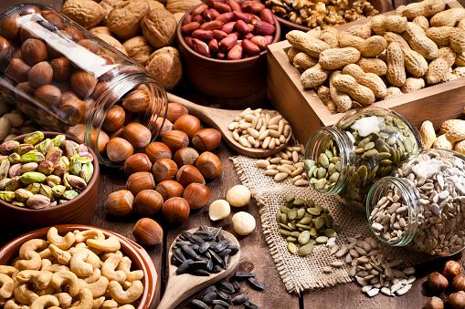 Nut - Food「Assortment of nuts on rustic wood table.」:スマホ壁紙(10)