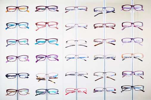 Consumerism「Assortment of glasses in an optician shop」:スマホ壁紙(14)
