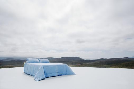 Double Bed「Double bed on platform overlooking rugged landscape」:スマホ壁紙(5)