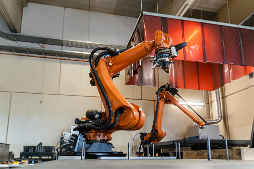 Robotics「Orange robotic arms manufacturing in industry」:スマホ壁紙(19)