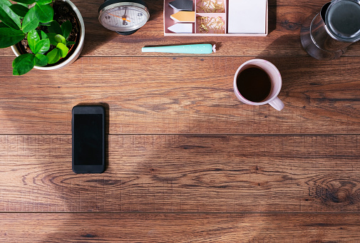 Directly Above「Wooden office desk with smartphone and coffee mug, top view」:スマホ壁紙(7)