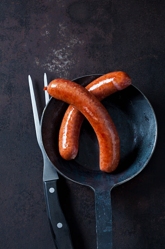 Sausage「Two minced pork sausage in pan and a meat fork on rusty metal」:スマホ壁紙(12)