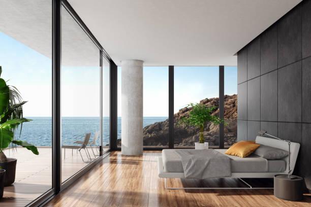 Modern luxurious bedroom in a seaside villa with black stone wall:スマホ壁紙(壁紙.com)