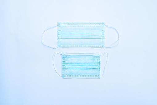 Allergy Medicine「Adult and Child Face Mask on Soft Blue Background.」:スマホ壁紙(6)