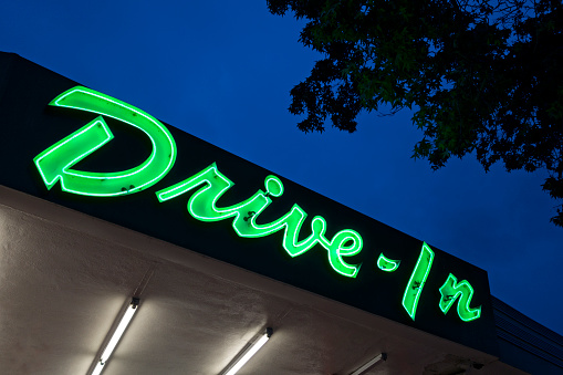 Unhealthy Eating「Neon drive in sign at dusk」:スマホ壁紙(3)