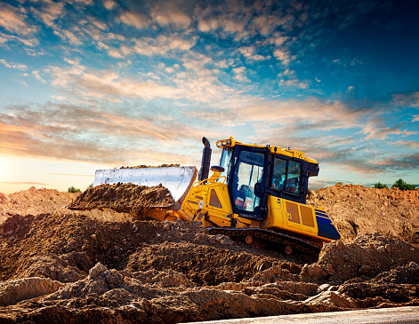 Construction Vehicle「Yellow bulldozer at a construction site」:スマホ壁紙(10)