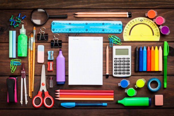 Top view of a large group of school or office supplies on wooden table:スマホ壁紙(壁紙.com)