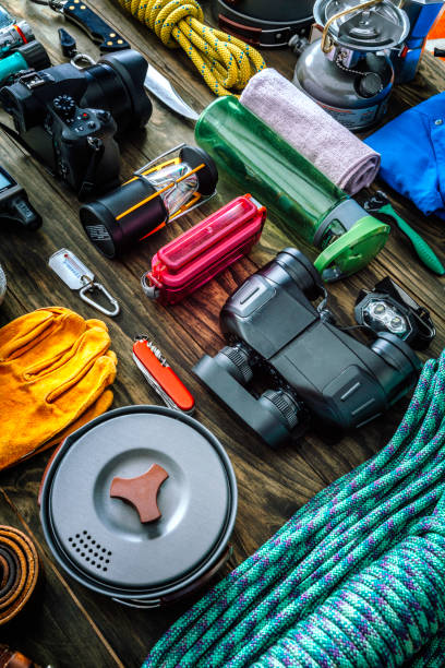 Top view of travel equipment and accessories for mountain hiking trip on wood floor:スマホ壁紙(壁紙.com)