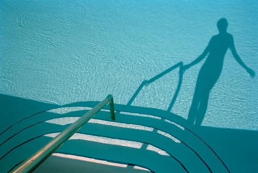 Unrecognizable Person「Shadow of woman walking down pool steps」:スマホ壁紙(2)