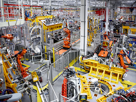 Orange Color「Robot arms in a car manufacturing factory」:スマホ壁紙(17)