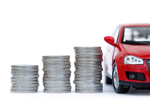 Insurance「Stacks of giant silver coins next to a new red car」:スマホ壁紙(1)
