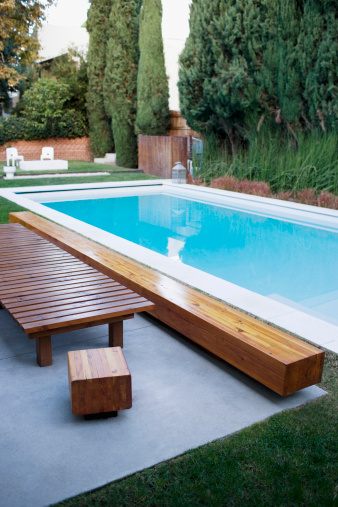 City Of Los Angeles「Modern wooden lounge chair next to swimming pool」:スマホ壁紙(6)