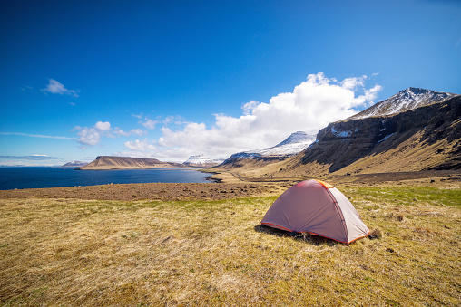 Wide Shot「Scenic landscape with a camping tent near seashore in Iceland」:スマホ壁紙(0)