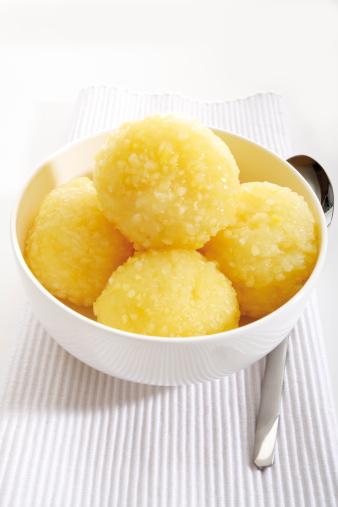 Dumpling「Potato dumplings in bowl with spoon on napkin, close-up」:スマホ壁紙(7)