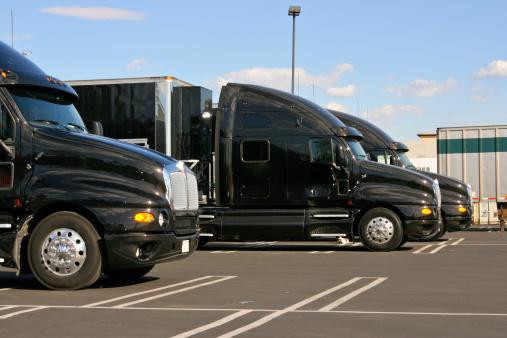 Passenger Cabin「Identical Black Truck Cabs used for Freight Transportation」:スマホ壁紙(3)