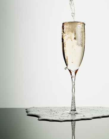 Wineglass「Champagne pouring into glass and overflowing」:スマホ壁紙(0)