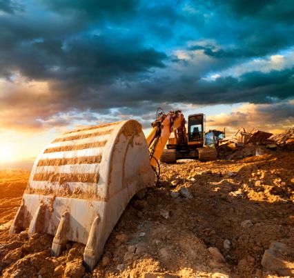 Bulldozer「Excavator at a construction site against the setting sun」:スマホ壁紙(11)