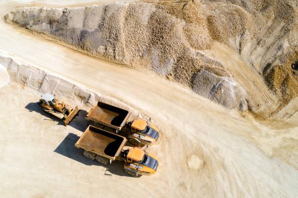 Dump Trucks and Bulldozer in a Quarry, Aerial View:スマホ壁紙(壁紙.com)