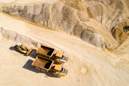 Construction Vehicle「Dump Trucks and Bulldozer in a Quarry, Aerial View」:スマホ壁紙(12)
