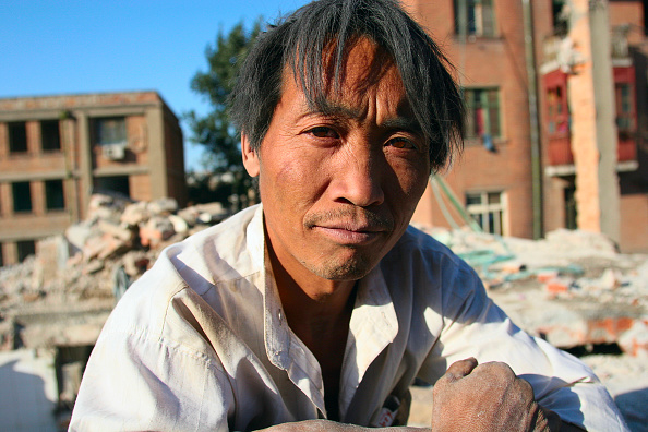 Vitality「A Chinese migrant labourer working on the demolition of residential housing in central Beijing」:写真・画像(3)[壁紙.com]