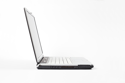 Computer Key「Side view of open laptop on white background」:スマホ壁紙(17)