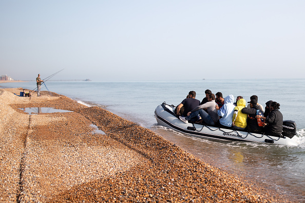 Fisherman「Migrants Land On Kent Beach After Crossing English Channel」:写真・画像(8)[壁紙.com]